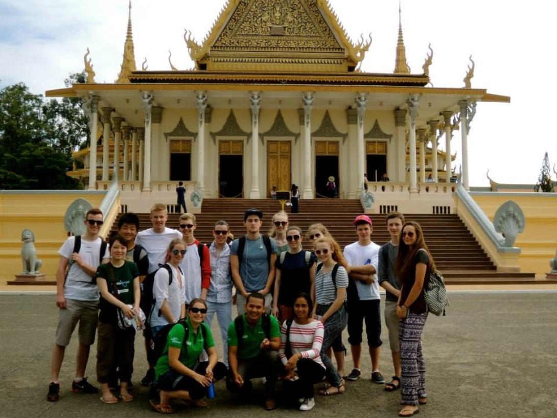 A group of teenagers volunteering in Cambodia tour Phnom Penh with Projects Abroad.